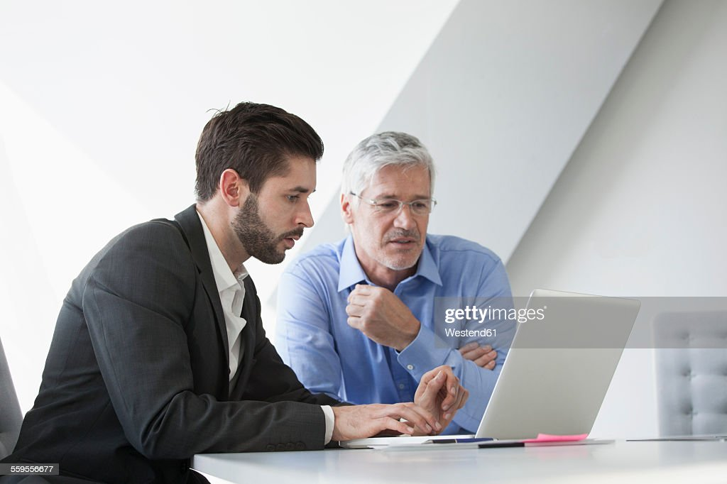 Businesspeople in informal meeting discussing new strategies