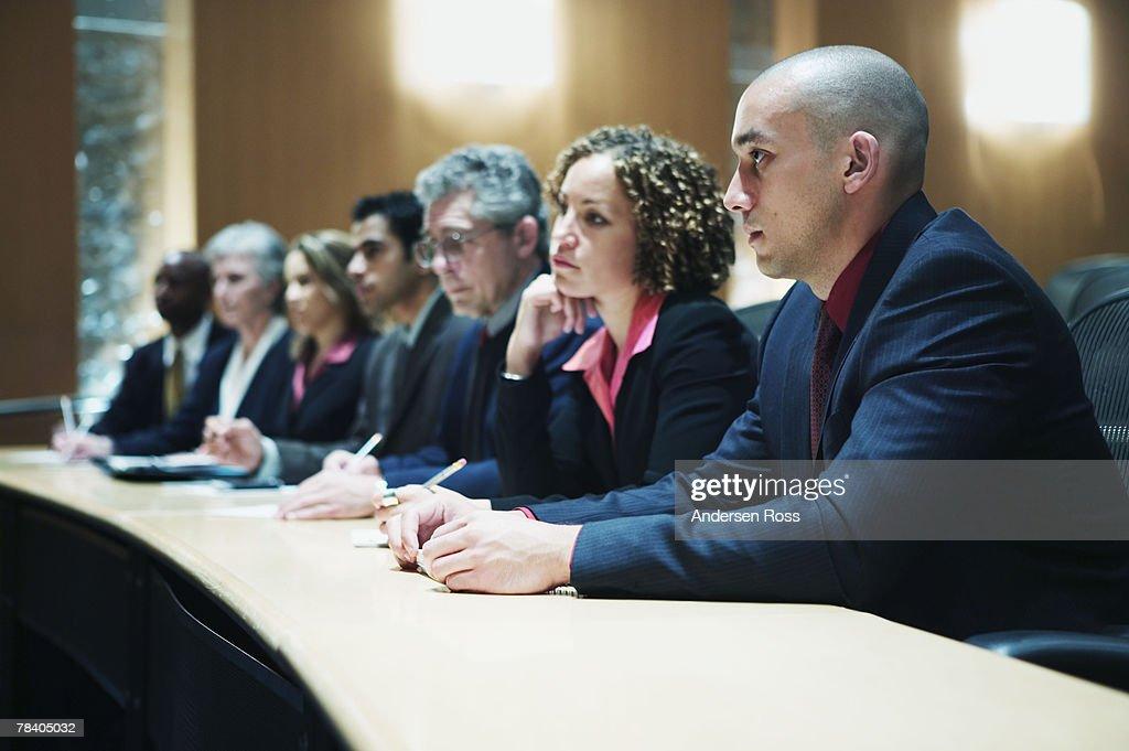 Businesspeople in judge's panel : Stock Photo