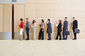 Businesspeople in line up