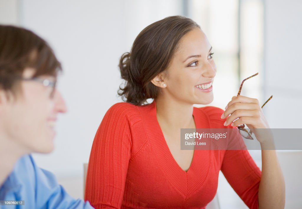Businesspeople in meeting, focus on businesswoman : Stock Photo