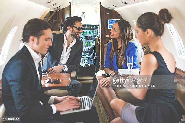 Businesspeople in private jet airplane