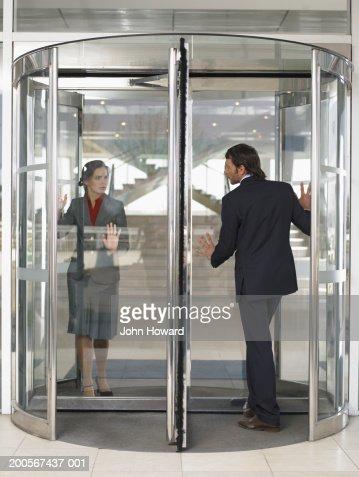 Businesspeople in revolving door