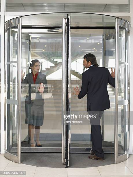 Businesspeople in revolving door