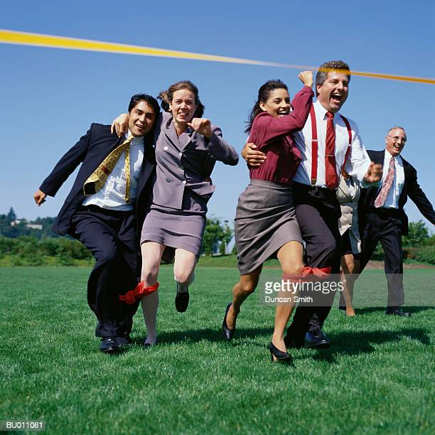 Businesspeople in Three-legged Race