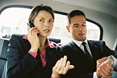 Businesspeople inside taxi