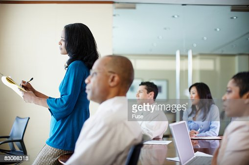 Businesspeople Listening in Meeting