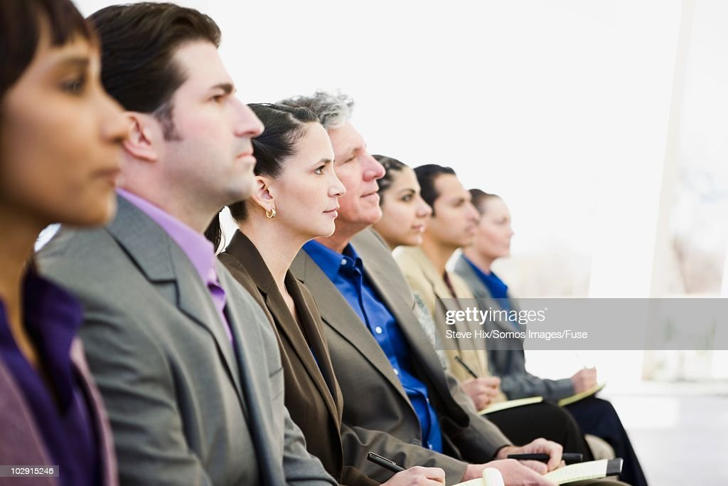 Businesspeople listening to a presentation
