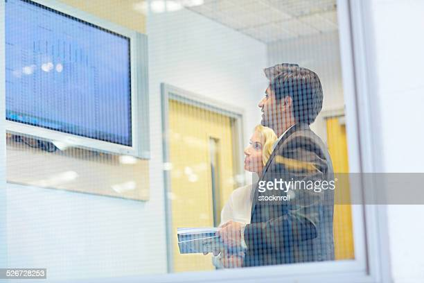 Businesspeople looking at graphically display
