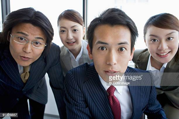 Businesspeople looking at PC screen, portrait