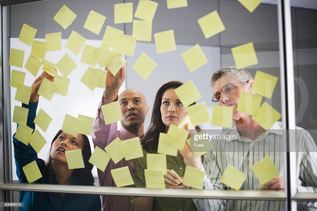 Businesspeople Looking at Sticky Notes