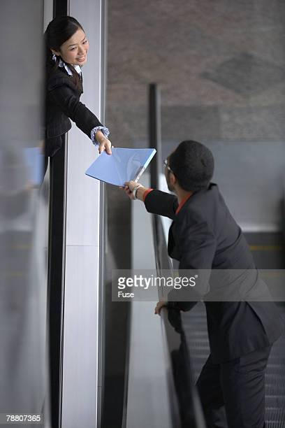 Businesspeople Making a Hand Off