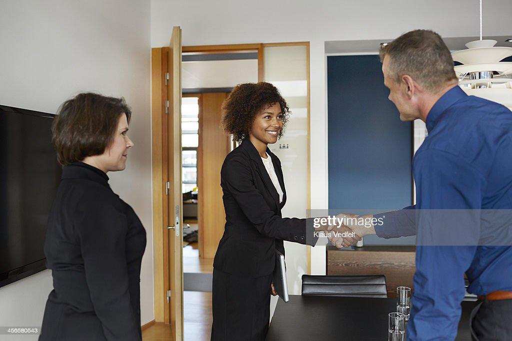 Businesspeople making handshake at job interview : Stock Photo