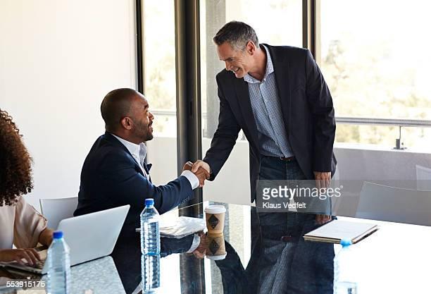 Businesspeople making handshake  before meeting