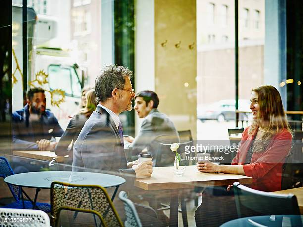 Businesspeople meeting in cafe drinking coffee