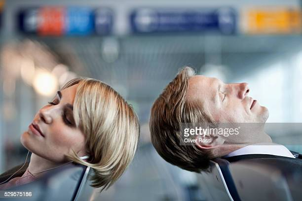 Businesspeople napping at airport terminal