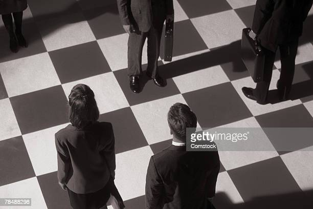 Businesspeople on a chessboard