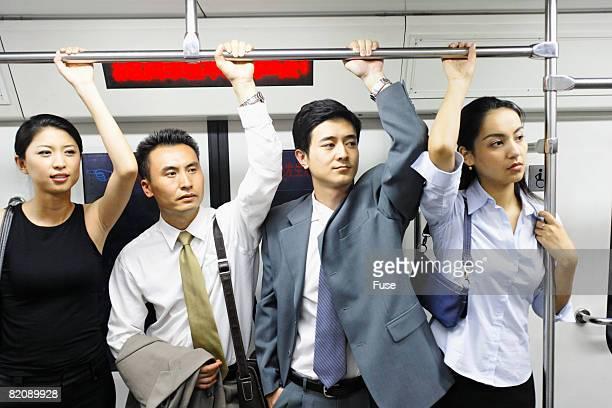 Businesspeople on Subway Train