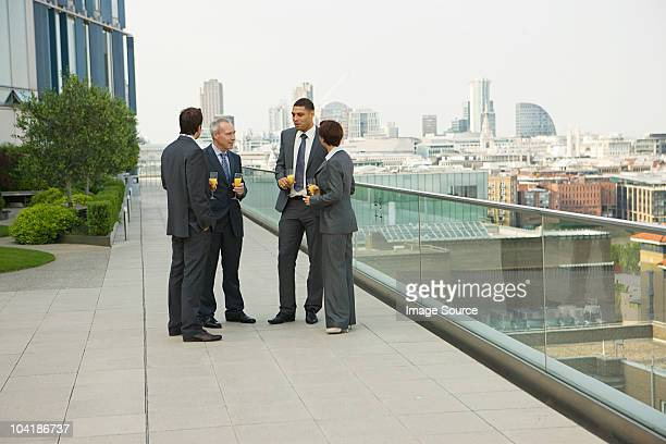Businesspeople outdoors with drinks