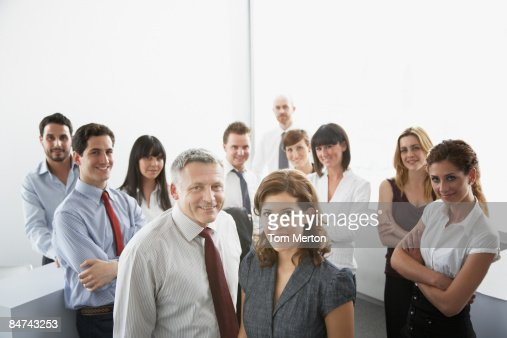 Businesspeople posing in office : Stock Photo