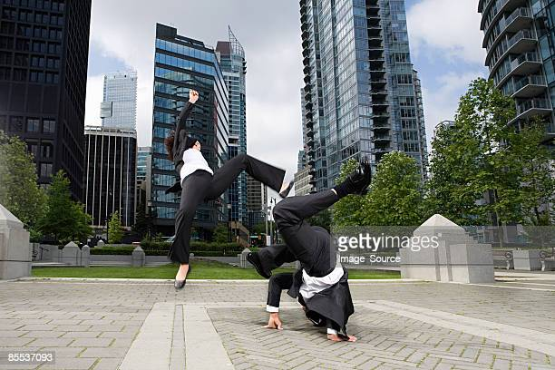 Businesspeople practising capoeira