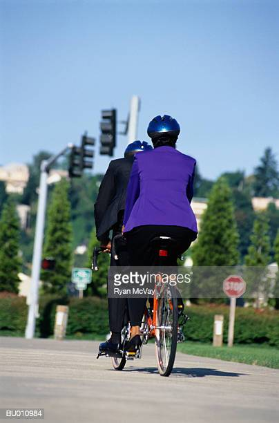 Businesspeople Riding a Tandem Bicycle