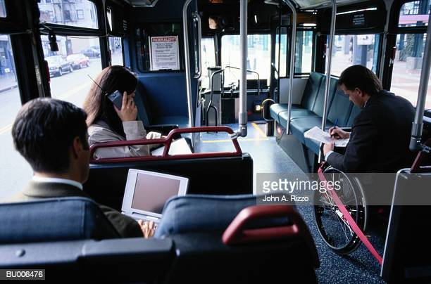 Businesspeople Riding Bus