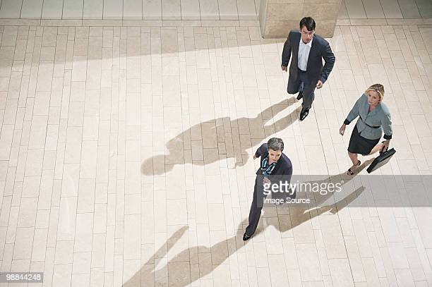 Businesspeople running in lobby