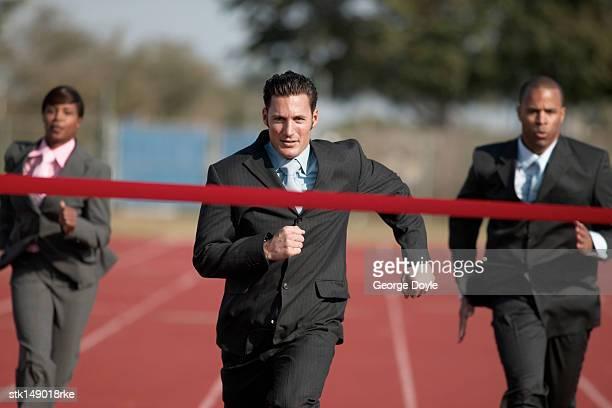 businesspeople running towards finish line