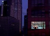 Businesspeople seen through skyscraper window