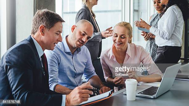 Businesspeople Sitting at a Table Discussing Plans