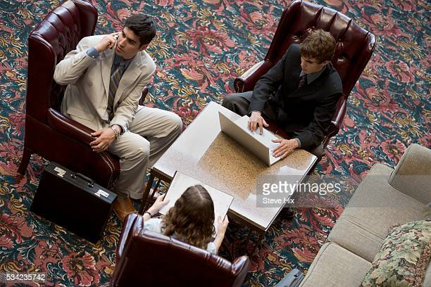 Businesspeople Sitting in Lobby