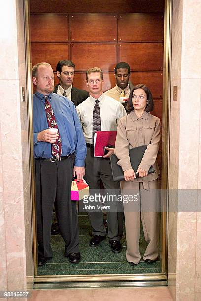 Businesspeople standing in an elevator