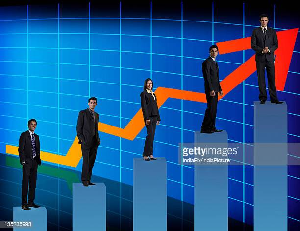 Businesspeople standing on a graph