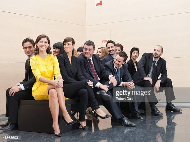 Businesspeople staring at unique co-worker