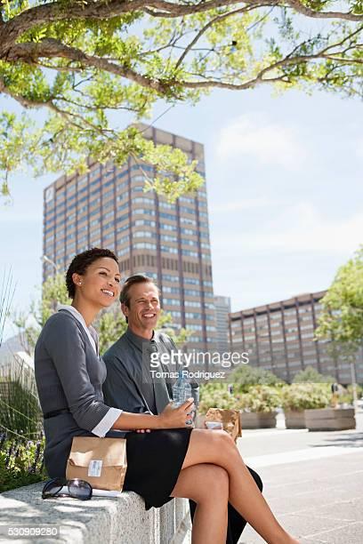 Businesspeople taking lunch break in park