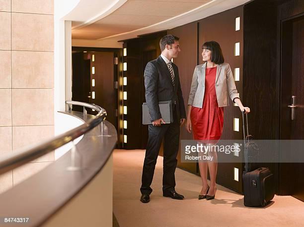 Businesspeople talking in corridor