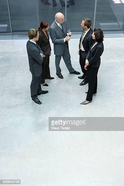 Businesspeople talking in lobby
