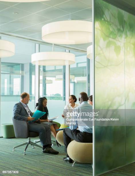 Businesspeople talking in meeting