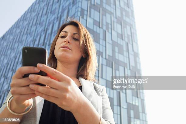 Businesspeople using cell phone outdoors