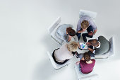 Businesspeople using digital tablet together