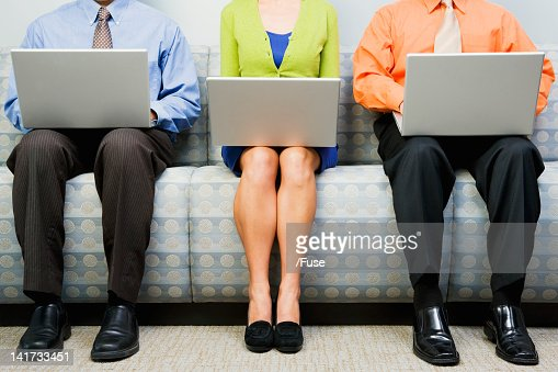 Businesspeople using laptops