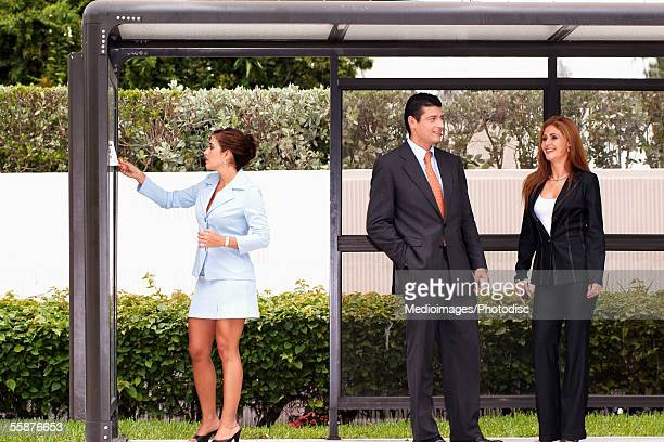 Businesspeople waiting at bus stop