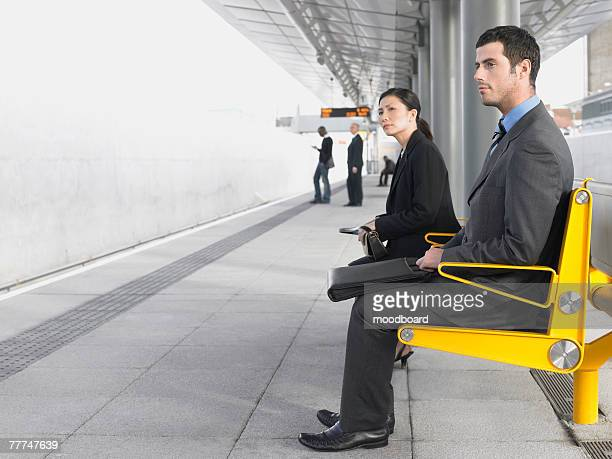 Businesspeople Waiting at Train Station