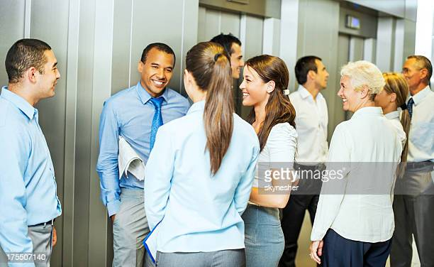 Businesspeople waiting for an elevator.