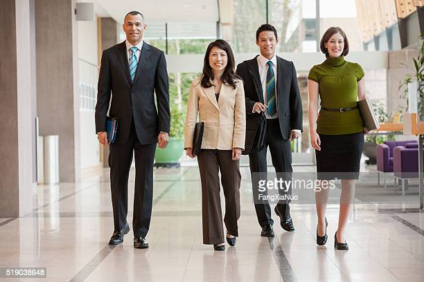 Businesspeople walking down a hallway