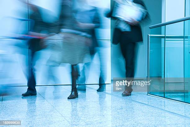 Businesspeople Walking in a Modern Interior, blurred motion