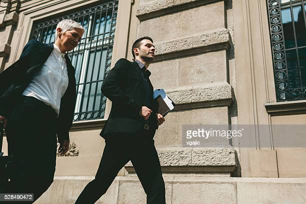 Businesspeople Walking In City.