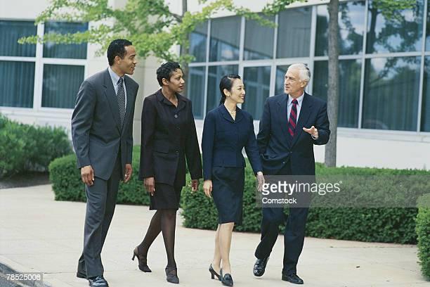 Businesspeople walking outdoors