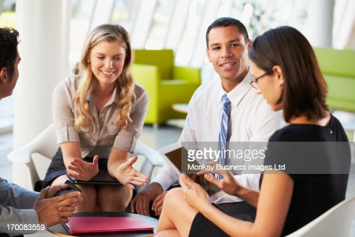 Businesspeople With Digital Tablet Having Meeting In Office : ストックフォト