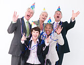 Businesspeople with party hats